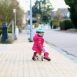 Little child playing on the street riding tricycle — Stock Photo #68115647