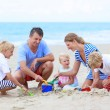 Happy family enjoying summer vacation on the beach — Stok fotoğraf #68115753