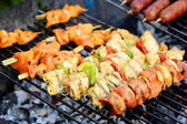 Assorted meat on grill — Stok fotoğraf