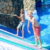 Two boys having fun in water park — Stock Photo