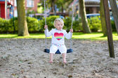 Toddler girl playing in the park — Stock Photo