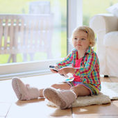Little girl watching tv at home — Stock Photo
