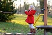 Preschooler girl having fun at playground — Foto de Stock
