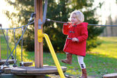 Preschooler girl having fun at playground — Stock Photo