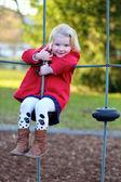 Toddler girl having fun at playground — Stock Photo