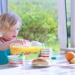 Funny girl enjoying healthy breakfast — Stock Photo #70841321