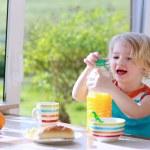 Funny girl enjoying healthy breakfast — Stock Photo #70841997