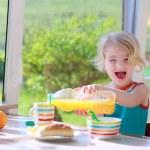 Funny girl enjoying healthy breakfast — Stock Photo #70842013