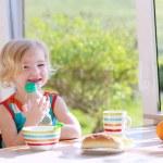 Funny girl enjoying healthy breakfast — Stock Photo #70842053