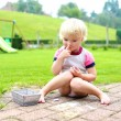 Preschooler girl drawing with chalk outdoors — Stock Photo #70842715