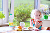 Funny girl enjoying healthy breakfast — Stock Photo