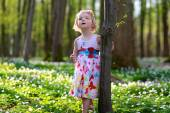 Adorable little girl enjoying spring blooming forest — Foto de Stock