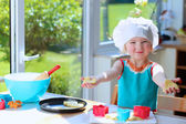 Happy toddler girl preparing cookies — Fotografia Stock