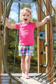 Toddler girl having fun at playground — Stock Photo