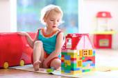 Little girl playing with construction blocks — Stock Photo