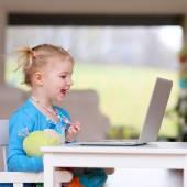 Little girl using laptop pc — Stock Photo