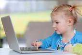 Little girl using laptop pc — Stock Photo