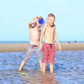 Two active boys playing on the beach — Stock Photo