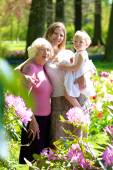 Daughter, mother and grandmother enjoying beautiful park — Stock Photo