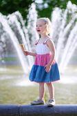 Cute little girl eating ice cream on summer day — Stock Photo