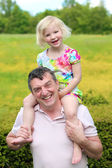 Father and daughter playing together outdoors — Stock Photo