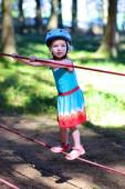 Brave little girl playing in adventure park — Stock Photo