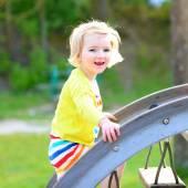 Little girl having fun at playground on summer day — Stock Photo