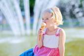 Cute little girl eating ice cream on summer day — Stock Photo