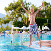 Happy boy having fun in swimming pool — Stock Photo