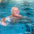 ������, ������: Active senior man swimming in the pool