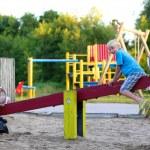 Happy kid having fun at playground — Stock Photo #79597822
