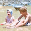 Kids playing with water and sand at summertime — Stock Photo #79598022