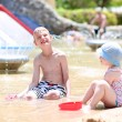 Kids playing with water and sand at summertime — Stock Photo #79598024