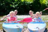 Happy family kayaking on the river — Stock Photo