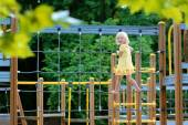 Little girl having fun at playground — Stock Photo