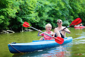 Father and son kayaking on the river — Stock Photo
