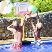 Two boys playing in swimming pool — Stock Photo