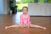 Little gymnast girl training at home — Stock Photo