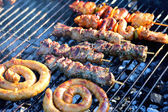 Assorted meat on grill — Stock Photo