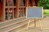 Blank Chalkboard with Bamboo Wood Stand Outdoor. — Stock Photo