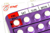 Strip of Contraceptive Pill on the Calendar with Start Taking Date Remark — Stock Photo