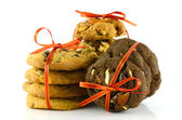 Cookies and Red Ribbons Isolated on White Background. — Stock Photo