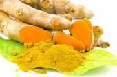 Turmeric (Curcuma longa L.) root and turmeric powder for alternative medicine ,spa products and food ingredient. — Stock Photo