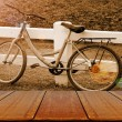 Old Bicycle in the Evening Light Background with Wooden Table. — Stock Photo #73272885