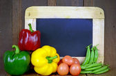 Colorful Asian Vegetable With Empty Chalkboard on Wooden Background. — Stock Photo