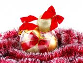 Christmas golden balls and red bow in a glass vase — Stock Photo