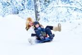 Mother and son enjoying a sleigh ride on a beautiful winter day — Stock Photo