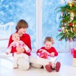 Kids opening Christmas presents — Stock Photo #53549311