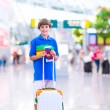 Boy traveling by airplane — Stock Photo #53549341