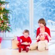 Kids opening Christmas presents — Stock Photo #53549421